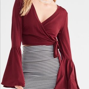 UO Celeste sleeve-bell wrap top.  Size M